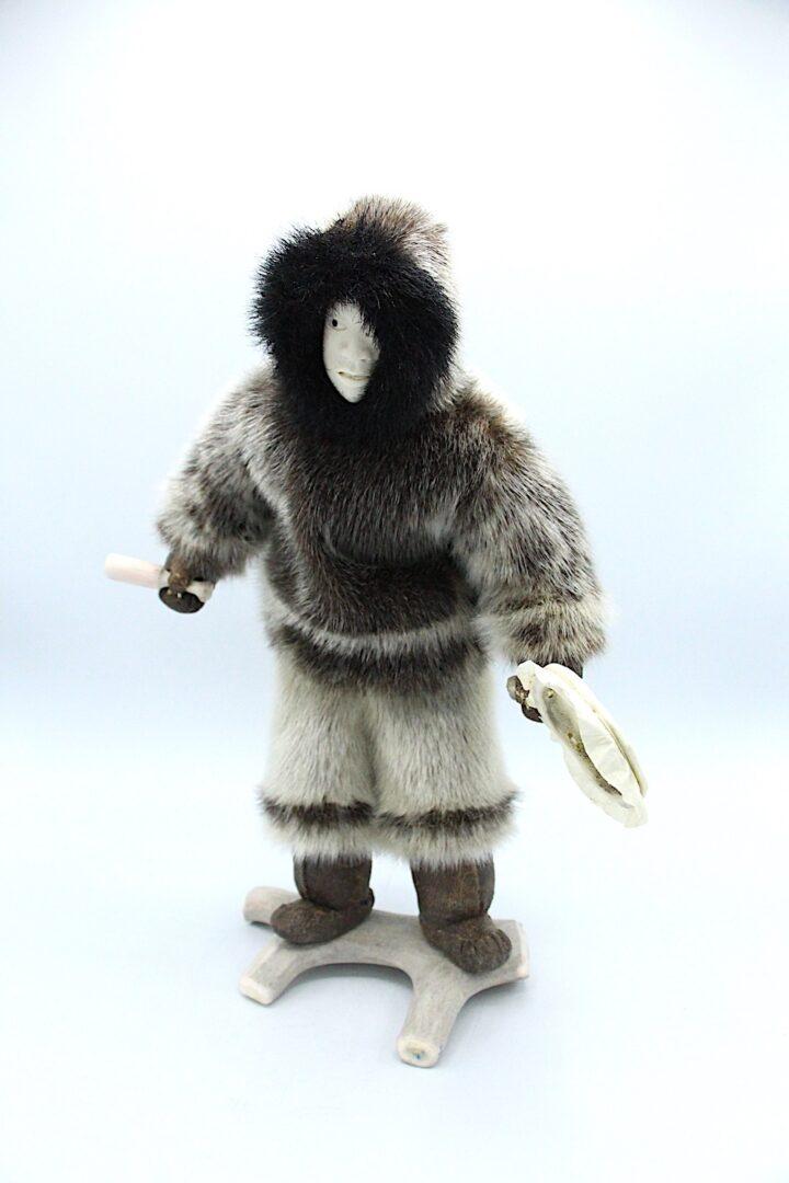 Inuit art doll in seal skin