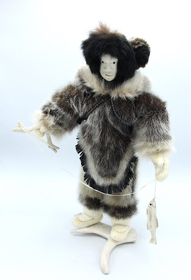 Inuit art doll in seal skin