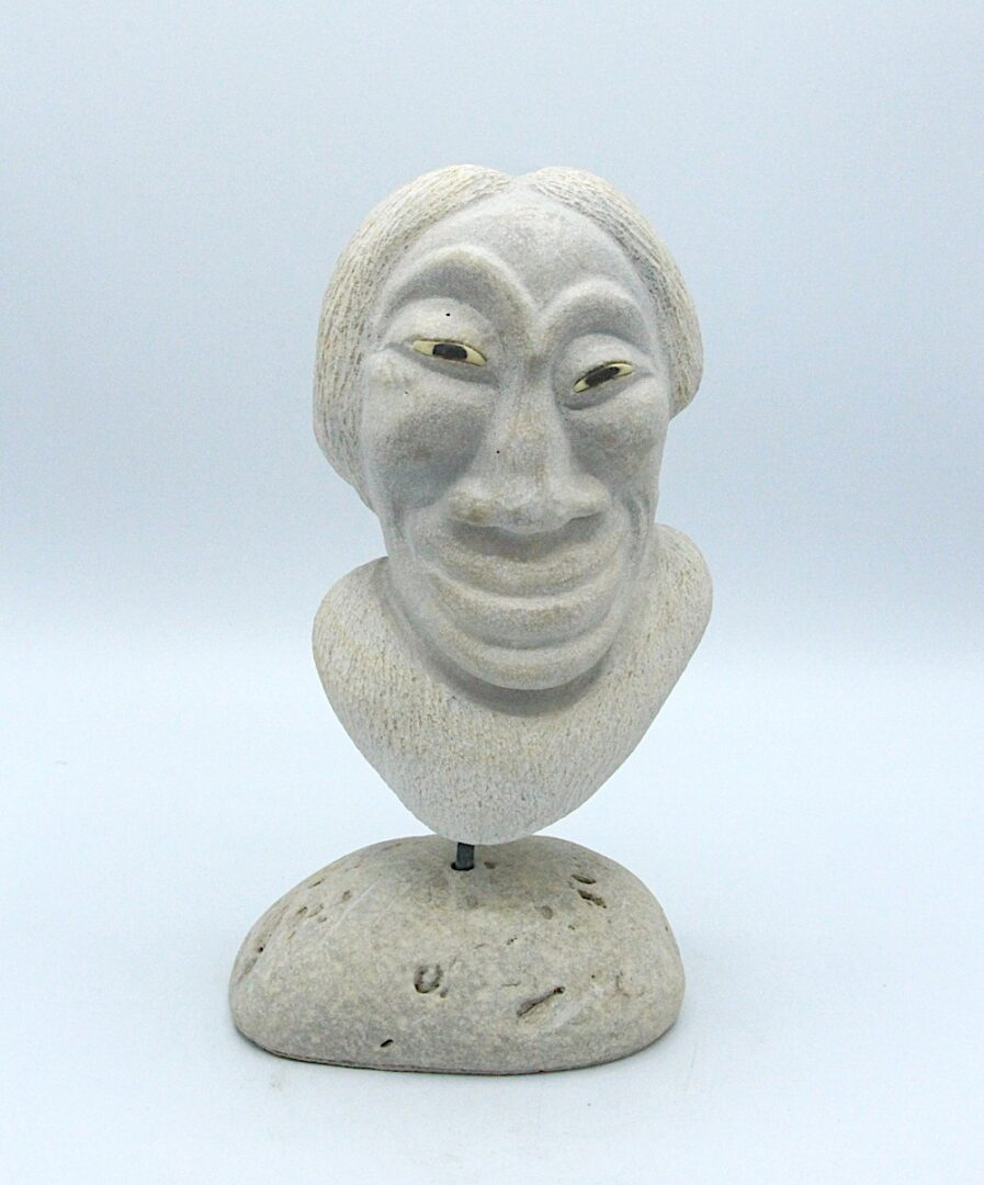 face inuit art sculpture in sandstone