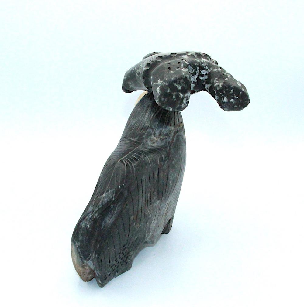 muskox tossing hunter Inuit Art Sculpture in basalt