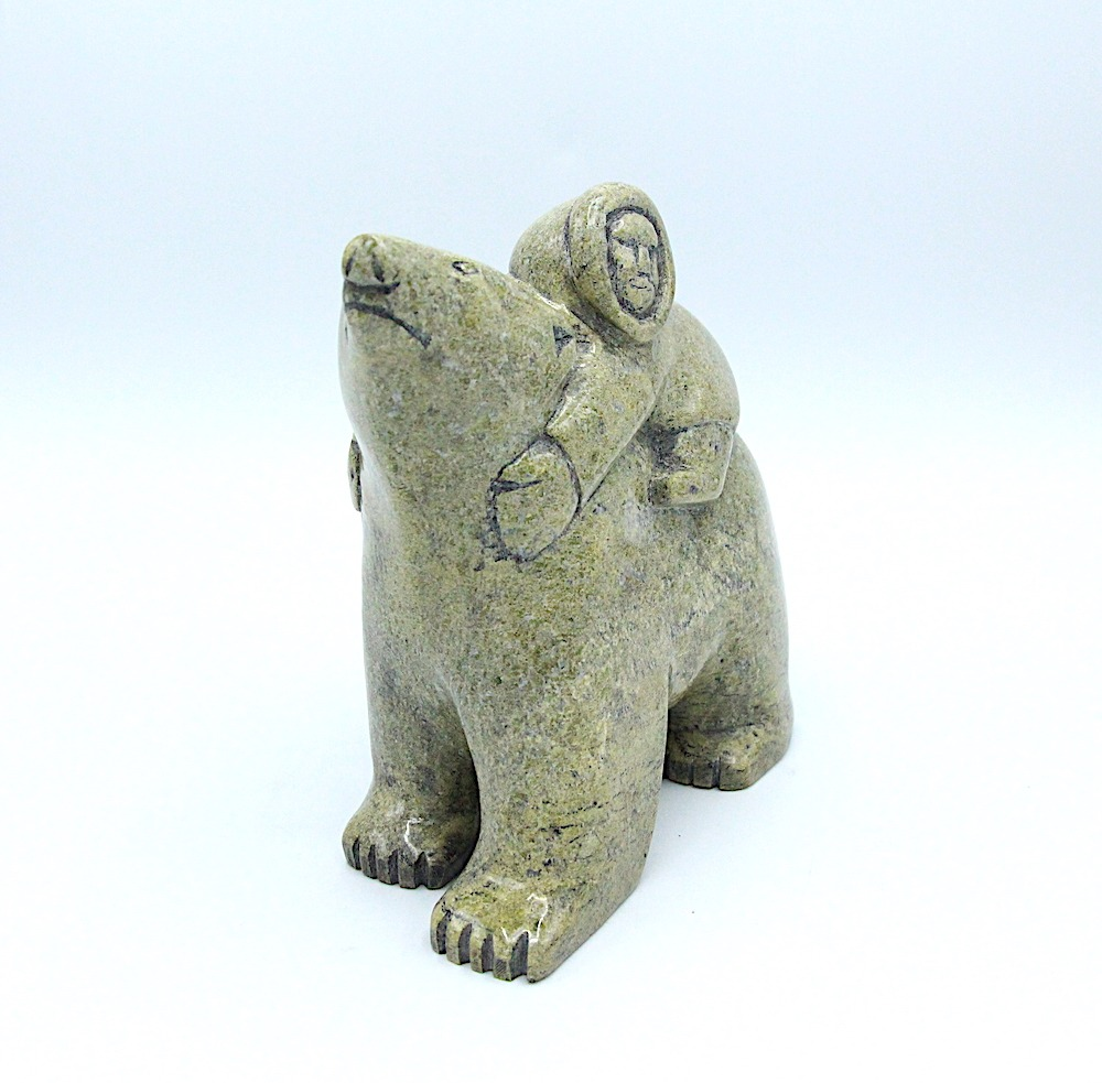 polar bear and boy Inuit Art Sculpture in Serpentine