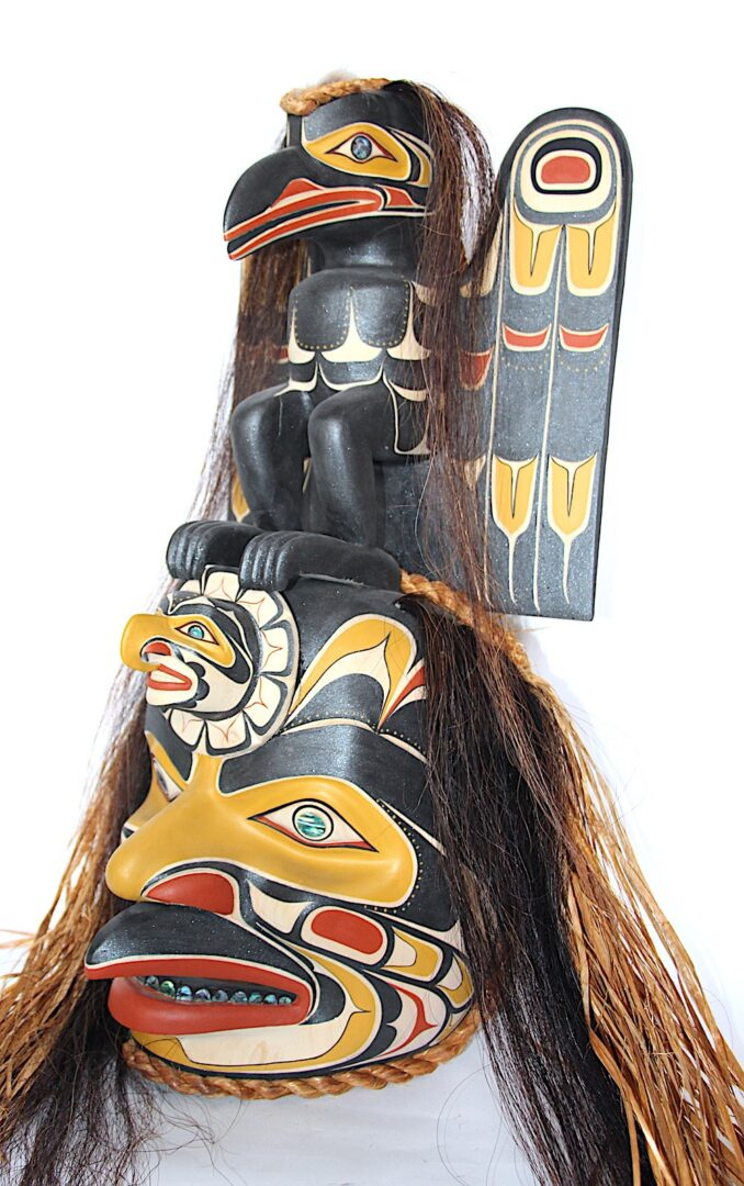 raven that stole the light west coast art in cedar wood and abalone
