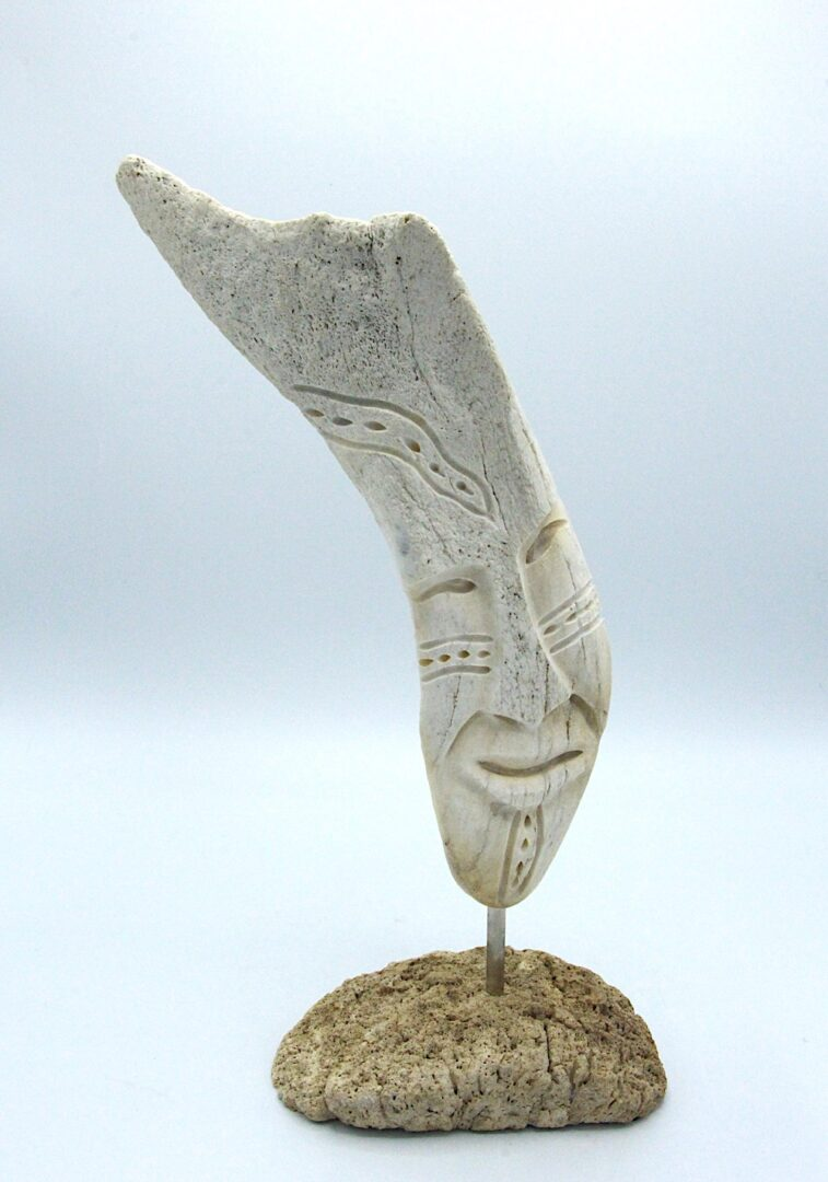 face inuit art sculpture in whale bone