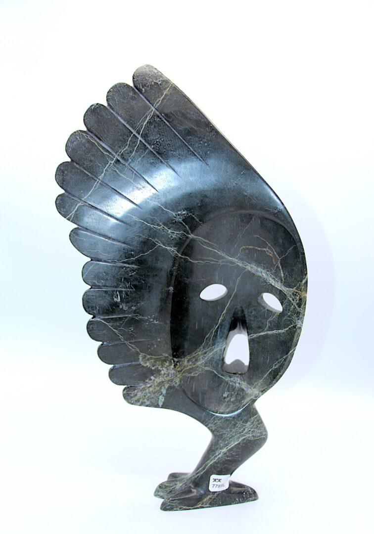 mask inuit sculpture in serpentine