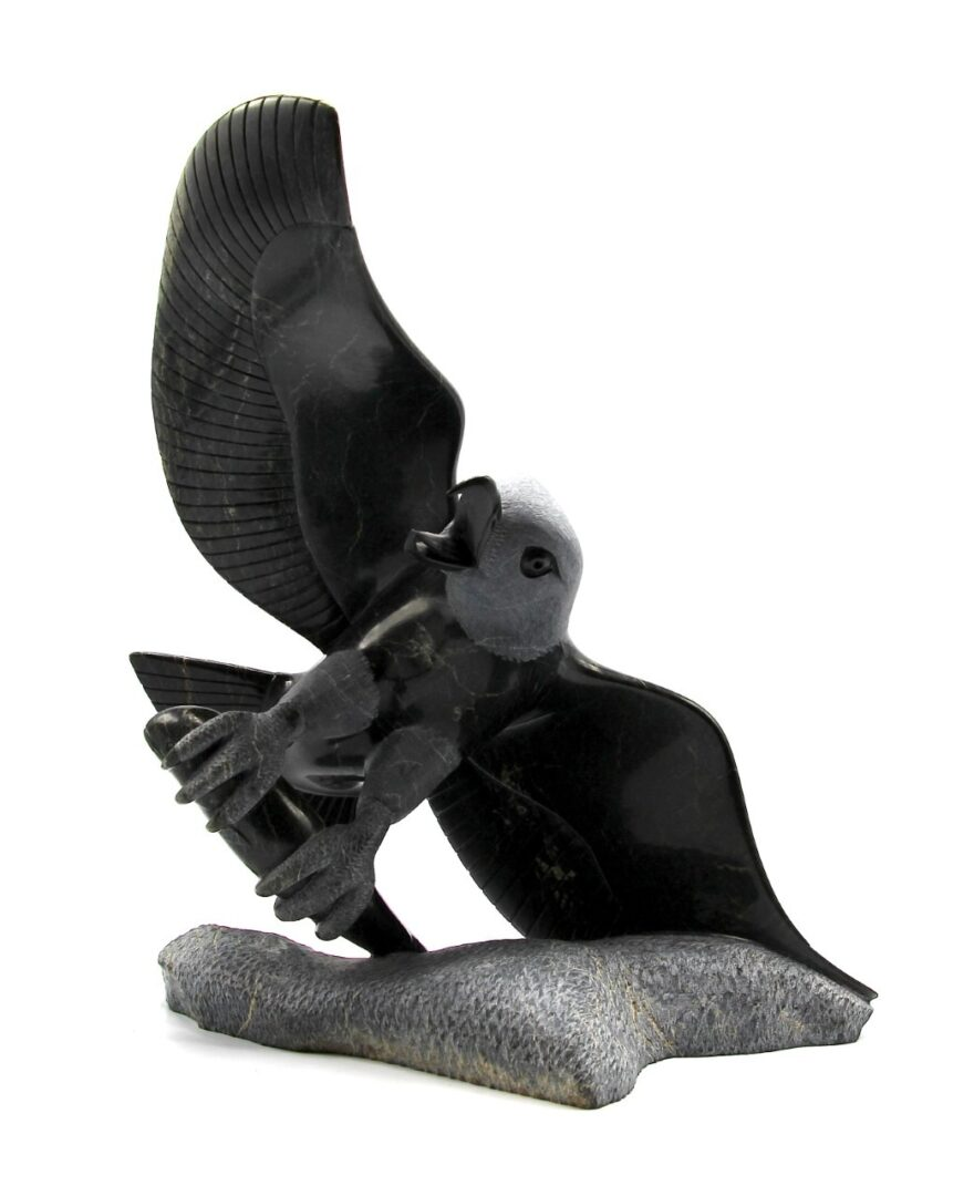 Eagle with fish kimmirut serpentine inuit art sculpture