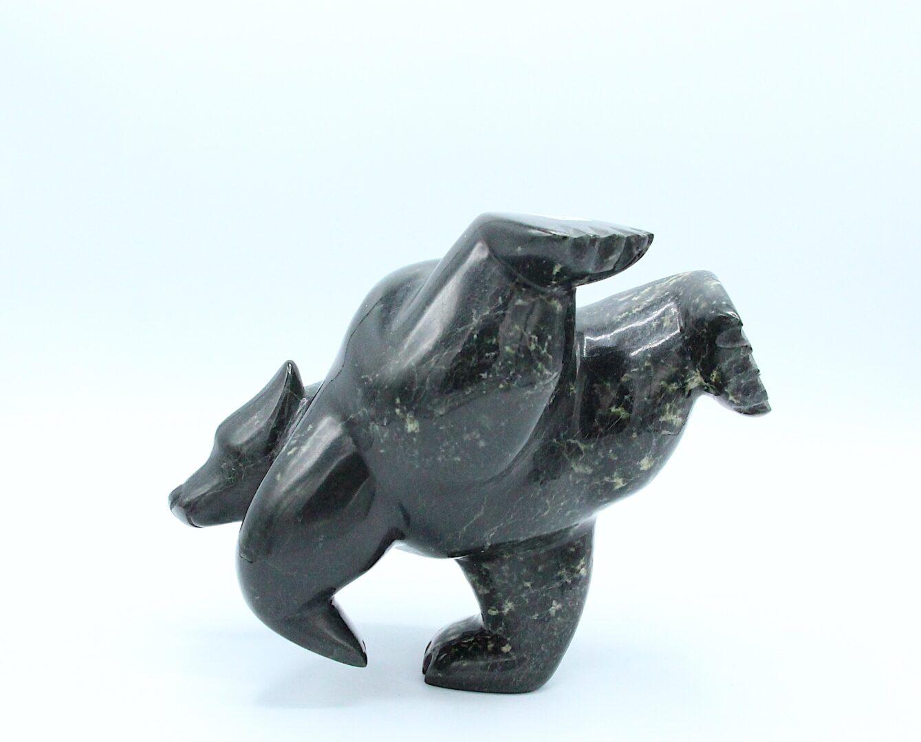 dancing diving bear Inuit Art Sculpture in Serpentine