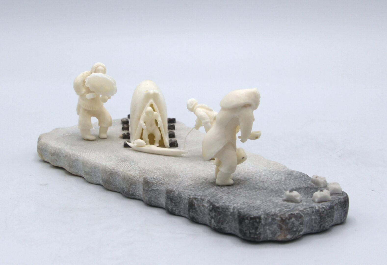camping out inuit art sculpture in marble and walrus ivory
