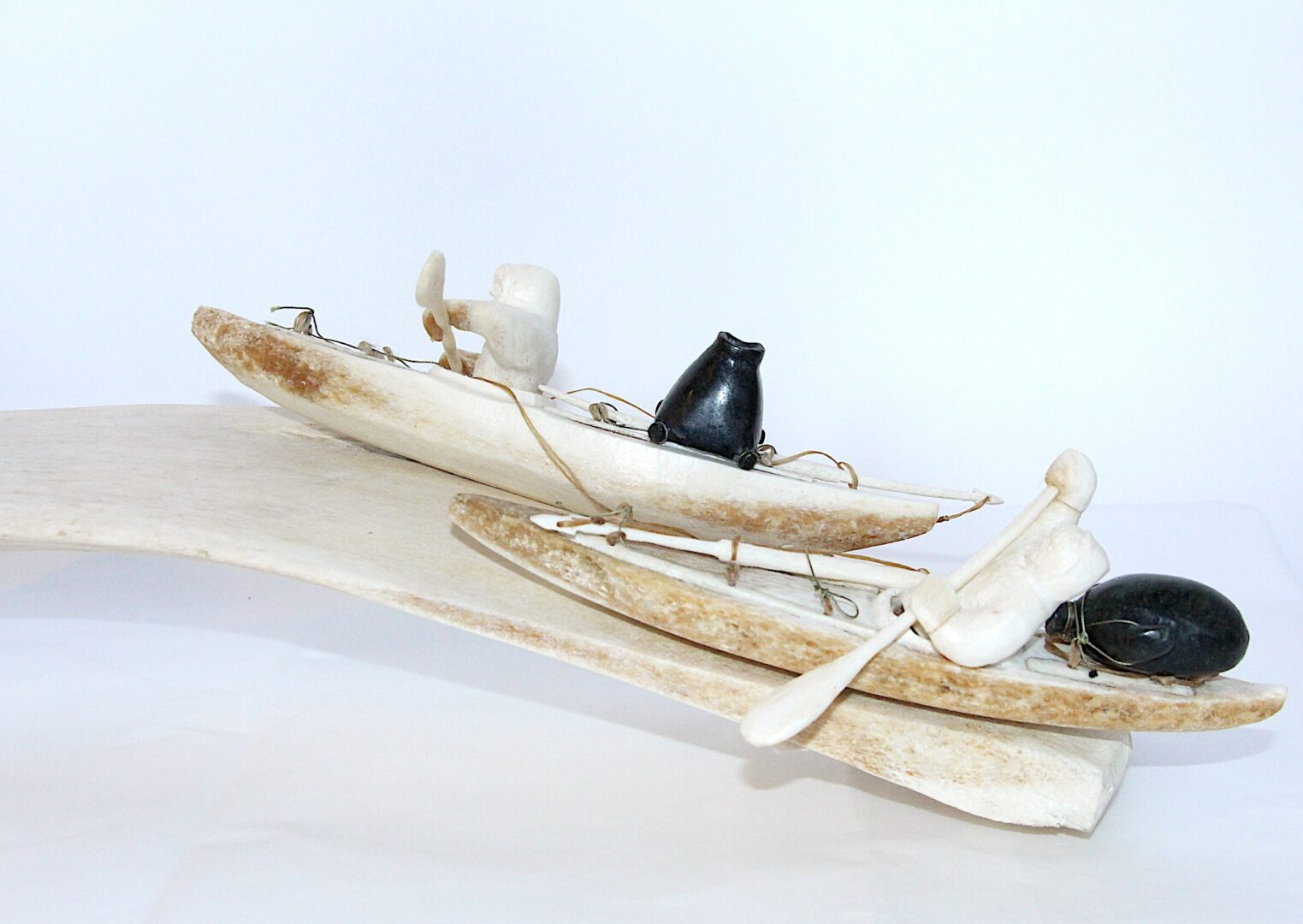 whalebone whale hunt scene inuit art sculpture in whale bone