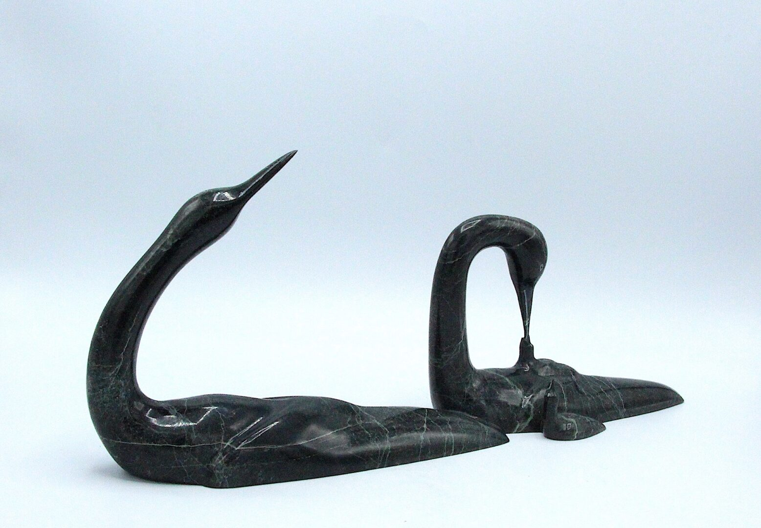 two loons feeding chicks Inuit Art Sculpture in Serpentine