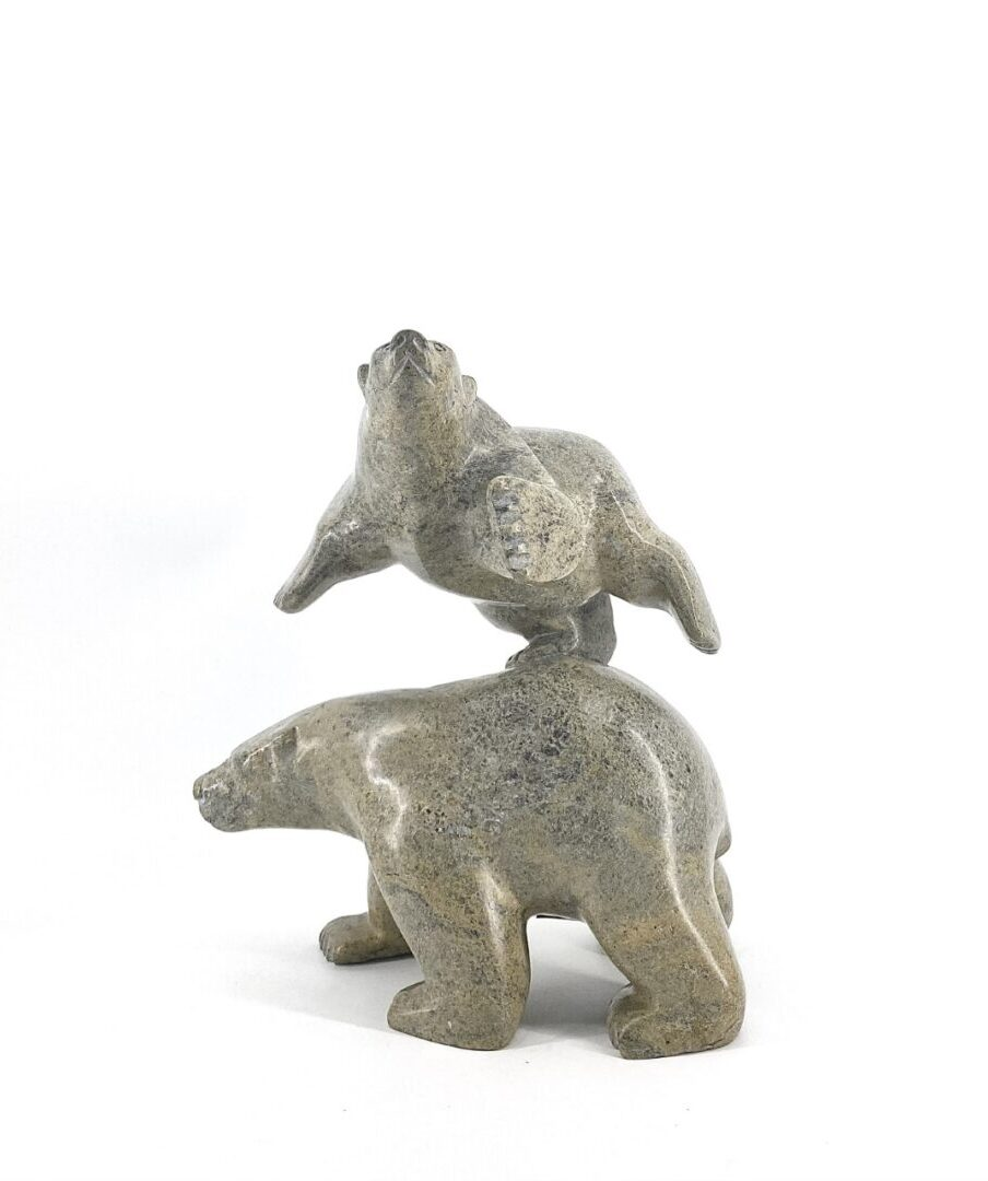 Original Inuit art sculpter carved by Joanie Ragee in serpentine stone. Bears 2850 from Cape Dorset, Nunavut