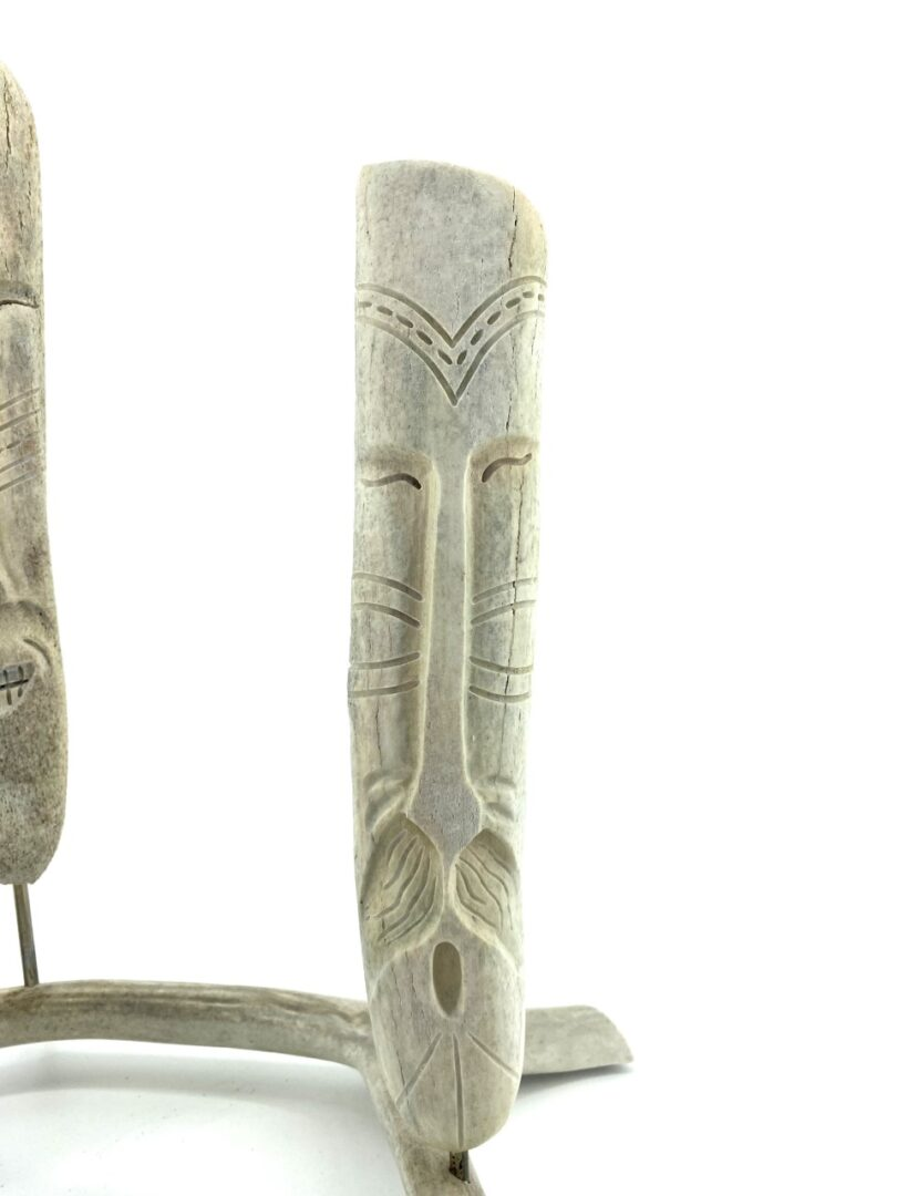original inuit art sculpture in whale bone and caribou antler by Billy Merkosak from Pond Inlet, Nunavut sculpted in 2019