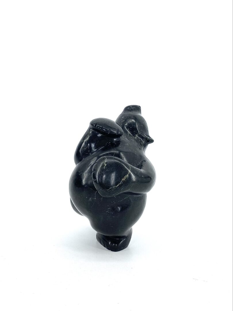 Original Inuit art sculpture made by Markoosie Papigatuk sculpted with serpentine in Cape Dorset