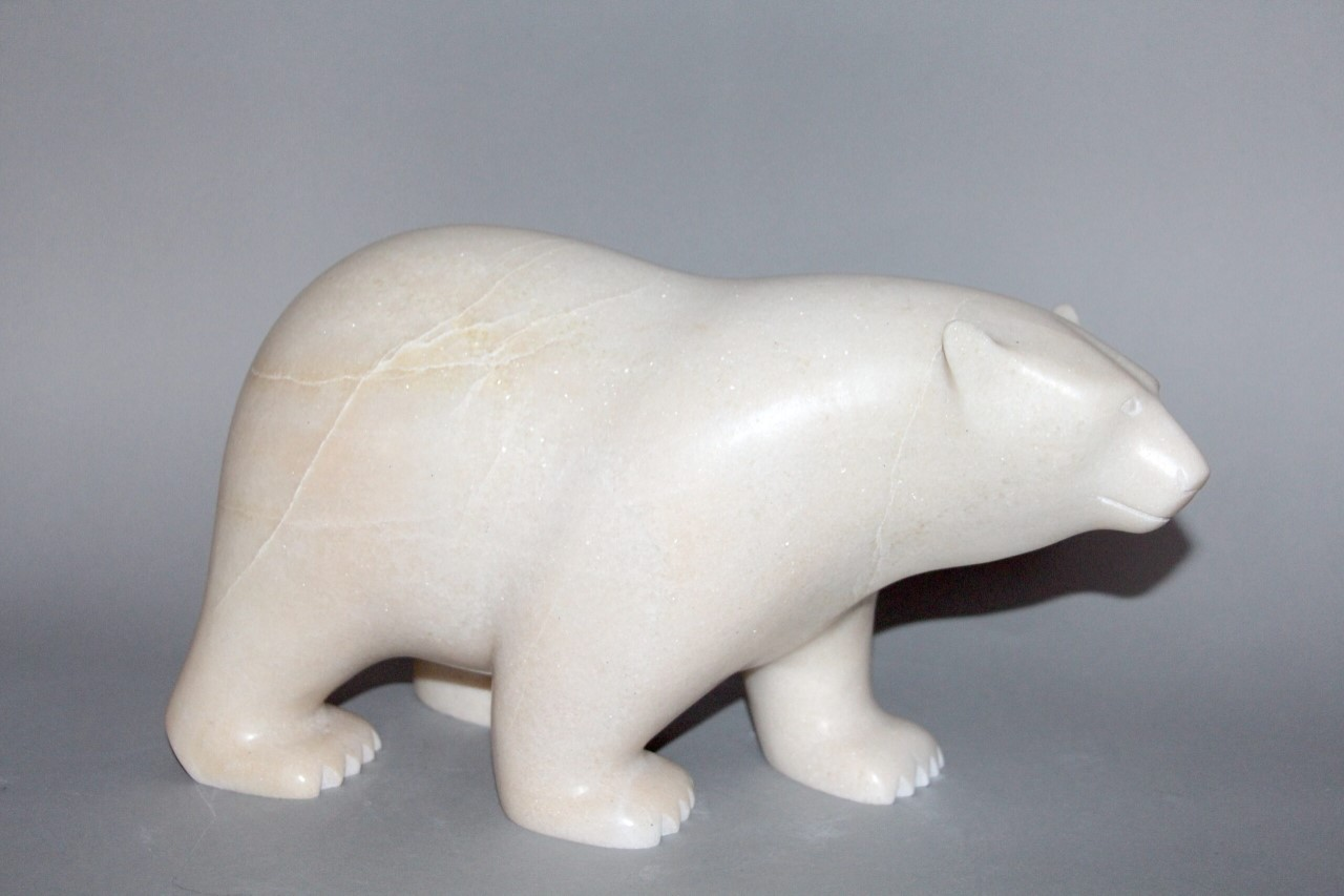 One original inuit art sculpture hand carved in white marble by Ashevak Adla ''Polar Bear 17133'' from Cape Dorset, Nunavut.