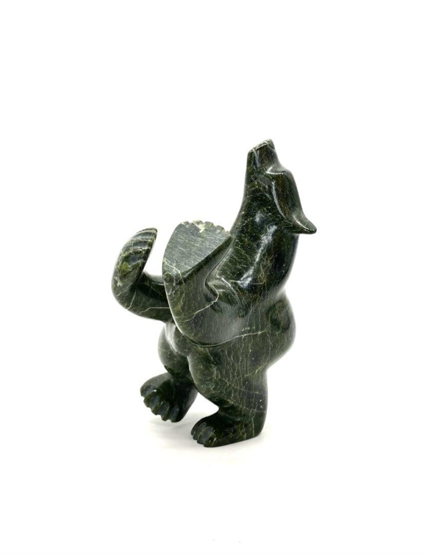 One original Inuit art sculpture hand carved by Ottokie Samayualie in Cape Dorset, Nunavut. ''Three Way Bear'' made of serpentine.
