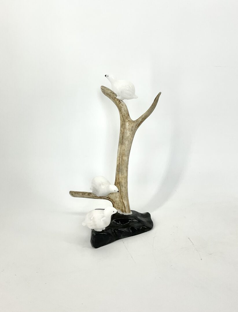 One original Inuit art sculpture hand carved by Peter John Mitchell