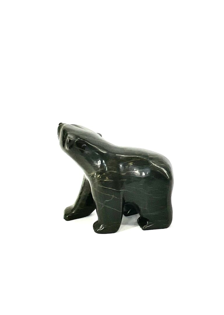 One original inuit hand carved sculpture made by Johnny Papigatukl in serpentine, from Cape Dorset, Nunavut ''Walking Bear 76-1246471''.