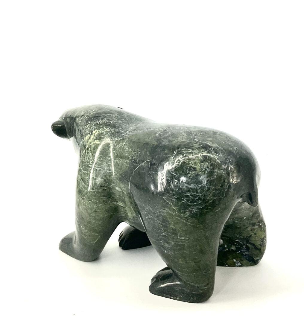 One original Inuit art carving by Ottokie Samayualie